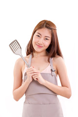 woman with apron, hand holding spatula, cooking concept