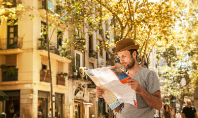 Tourist man looking at the city map - summer holiday traveling