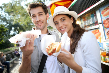 Tourists in New York city eating hot dogs