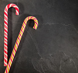 Two Candy Canes On Black Background