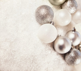 Silver And White Baubles On Snowy Background