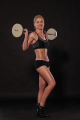 fitness girl with a barbell