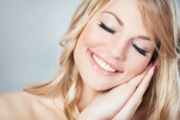 Portrait of a beautiful blond woman with her eyes closed