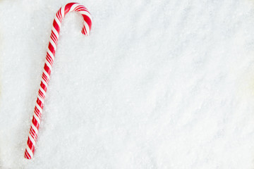 Candy Cane On Snowy Background