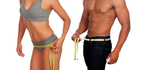 Bodies of man and woman measuring the waist with tape measure