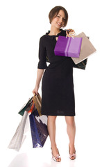 Smiled girl carrying shopping bags after hard shopping day