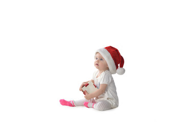 baby girl in Santa hat