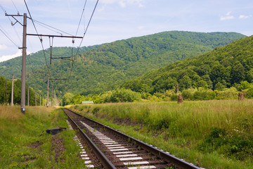 Railway tracks in a rural scene