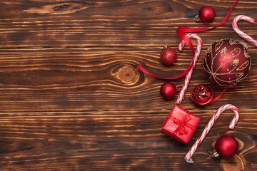Christmas Decorations. Gift Box. Candy Canes. Wooden Background