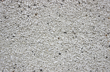 rough wall background with prominent porous patches