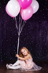 Little girl with pink balloons