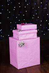 Purple gift boxes with glittery background