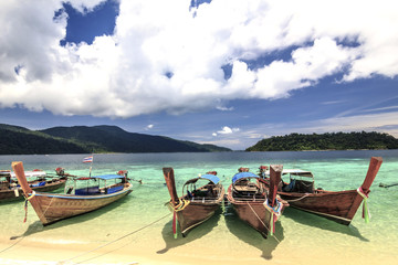 Longtail boat  and  Tropical beach with white sand