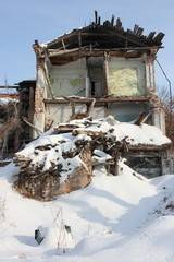 Deserted and a demolished old brick house in the winter city