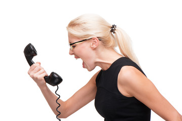 Young business woman screaming on telephone