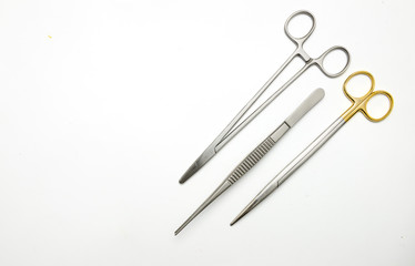 Surgical scissor forceps and needle holder on white background