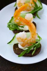 appetizer canape with fresh cucumber, arugula and shrimp