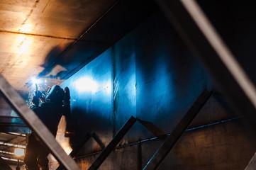 Heavy industry welder worker in protective mask
