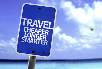 Travel Cheaper Longer Smarter sign with a beach