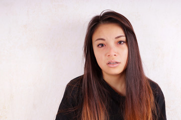young asian woman cries