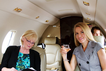 Two passengers relaxing on jet