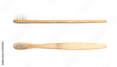 wooden toothbrush on white background - 72675927