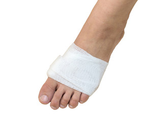 White medicine bandage on injury foot with white background, iso