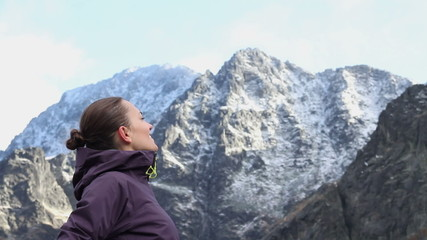 female tourist enjoying beautiful view in the mountains, Tatras