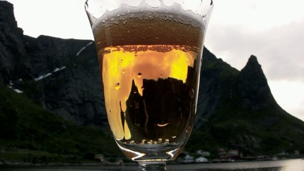 A glass of beer in the Norwegian sunset