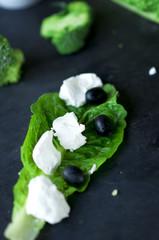 Feta cheese on  green Cos lettuce