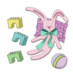 Set of children's toys with a pink teddy rabbit