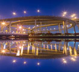 The Bhumibol Bridge with river at twilight, bangkok, thailand