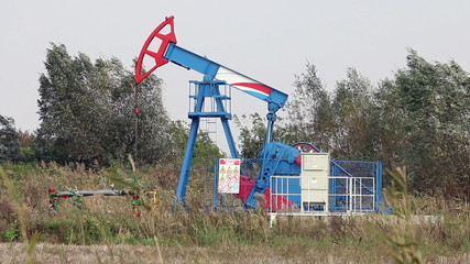 oil pump jack on windy field