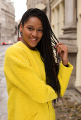 beautiful  woman wearing a colourful yellow jumper.