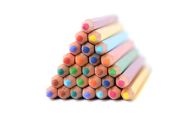Pyramid of color pencils isolated over white
