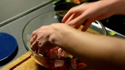 man prepares salad - man mixed salad