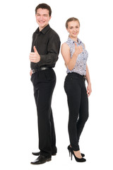 Side view portrait of happy couple showing thumbs up sign while