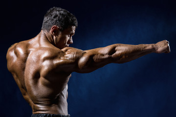 Strong Athletic Man Fitness Model shows the kick