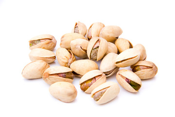 Pistachios on white background viewed from front