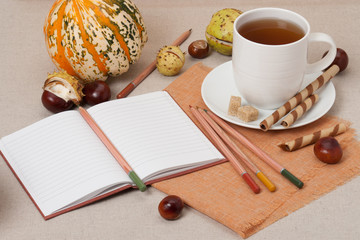 Opened Notebook. Cup Of Hot Tea With Sweets. Natural Linen Table