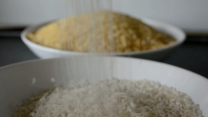 pouring white rice into plate - natural rice in background