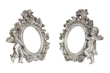 Set of oval baroque silver picture frames with cupid isolated