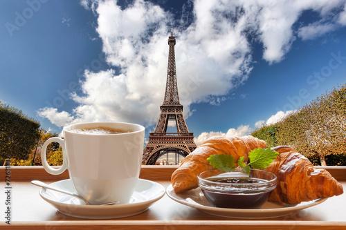 Fototapeta Coffee with croissants against Eiffel Tower in Paris, France