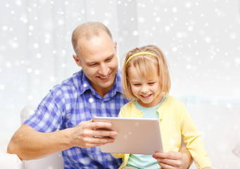 happy father and daughter with tablet pc computer