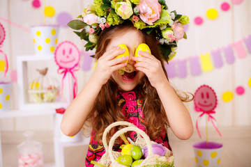 Easter concept. Beautiful girl in the room with decorations