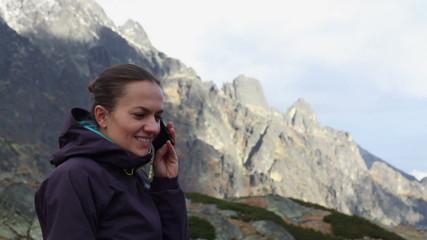 Woman talking on cellphone in the mountains, Tatras, Slovakia