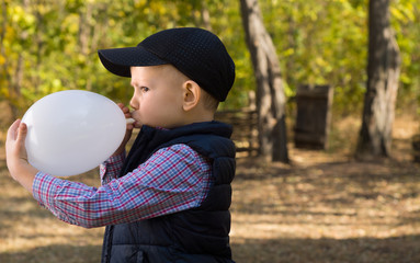 Cute Kid Inflating White Balloon Seriously