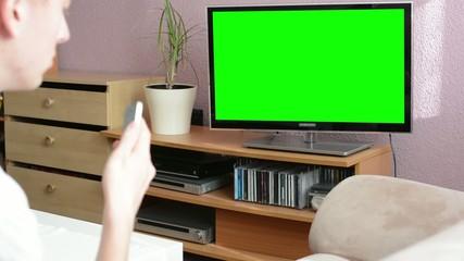 Man watches TV(television) - green screen - man phone