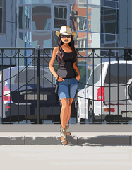 Girl in a cowboy hat on a hot day in the city