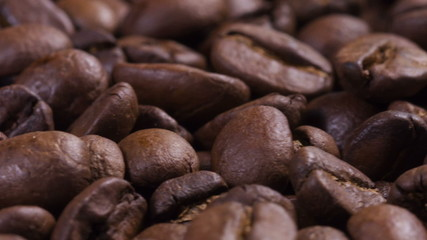 close up footage of rotating roasted coffee beans, loop video